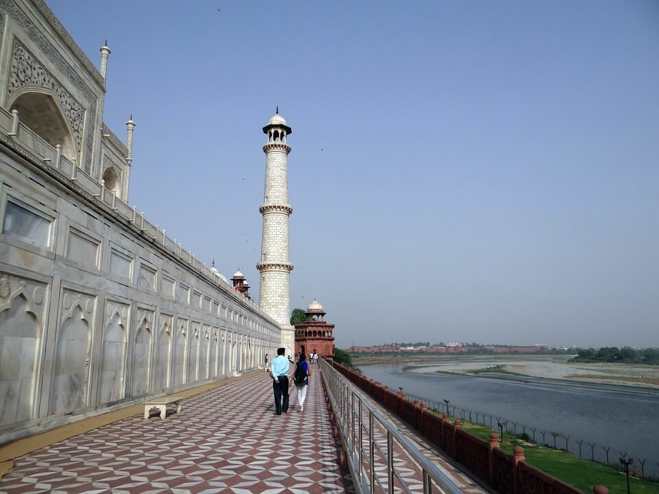 View the Taj Mahal from the deck of the Yamuna River cruise boat
