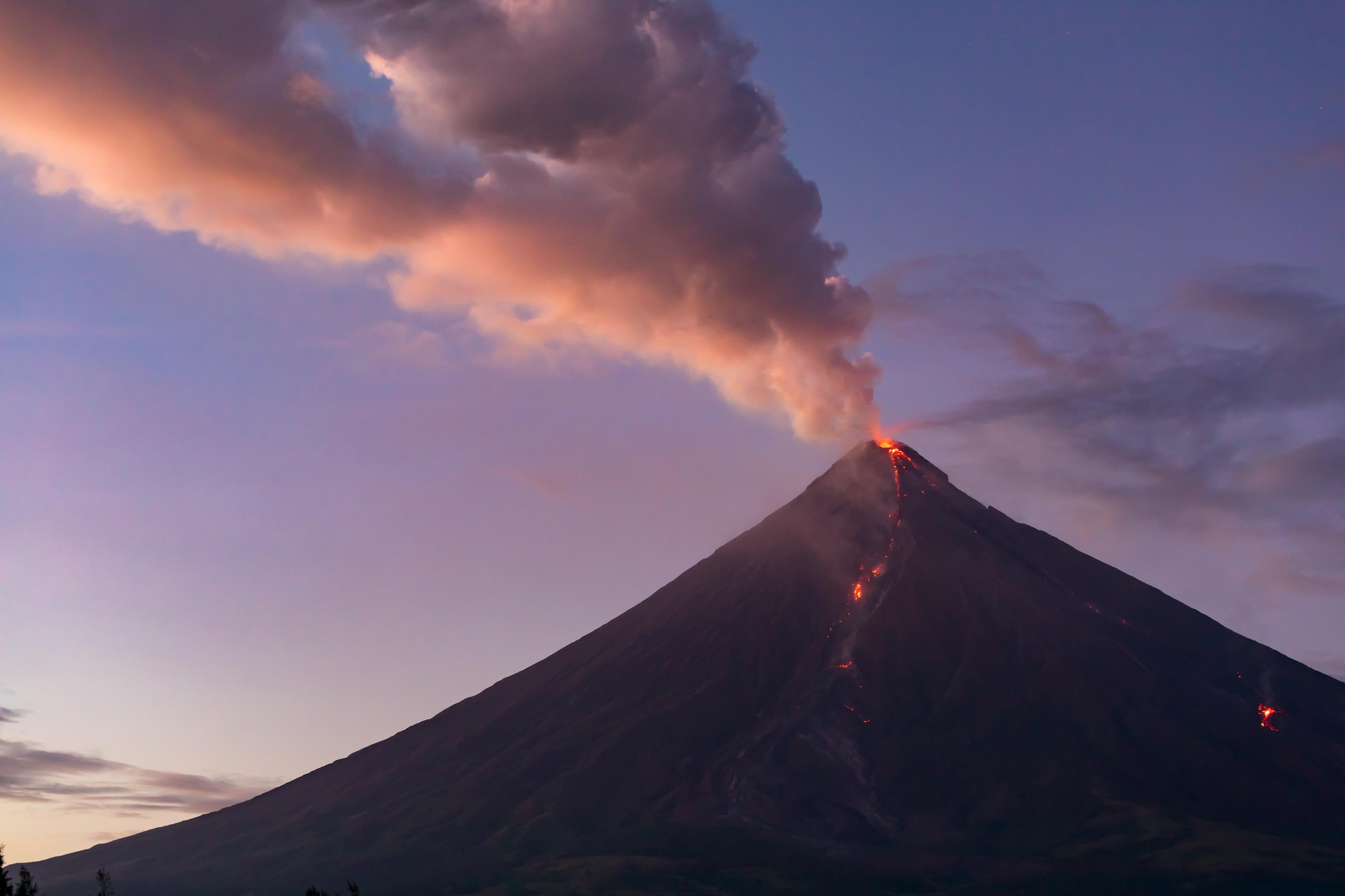 smoking Mayon Volcano at sunset