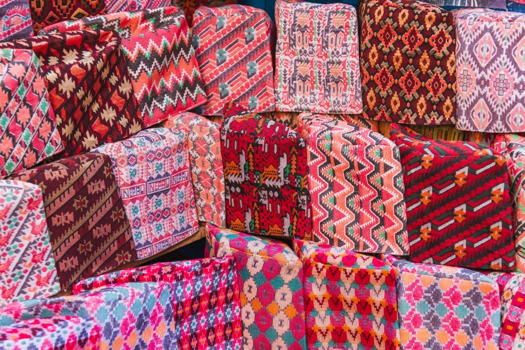 traditional Nepalese textiles with geometric patterns for sale at Asan Market