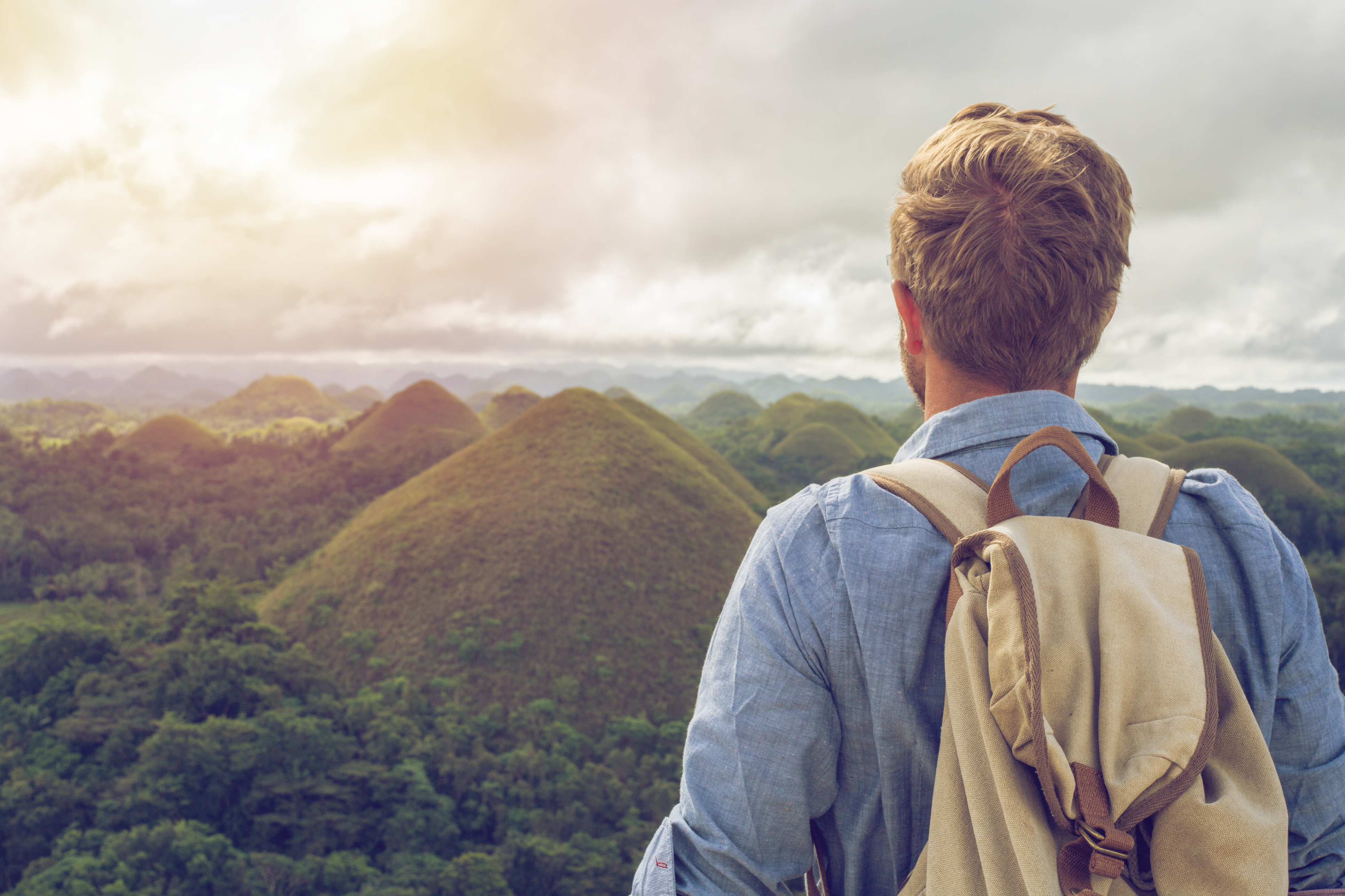 Man gazing over Chocolate Hills in the Philippines