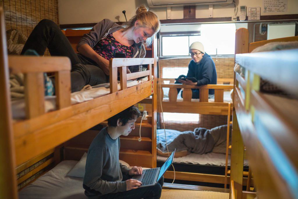 backpackers socializing in a hostel