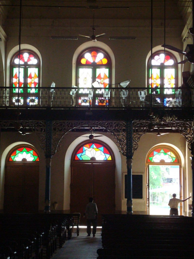 View of the stained glass windows illuminated inside the cathedral.