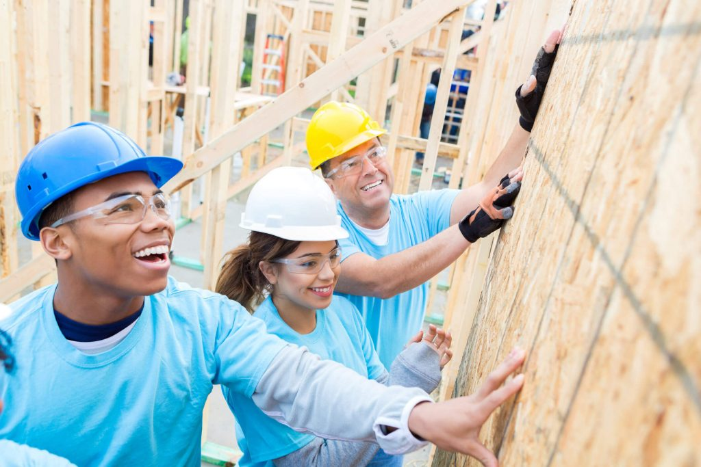 Volunteers build a house