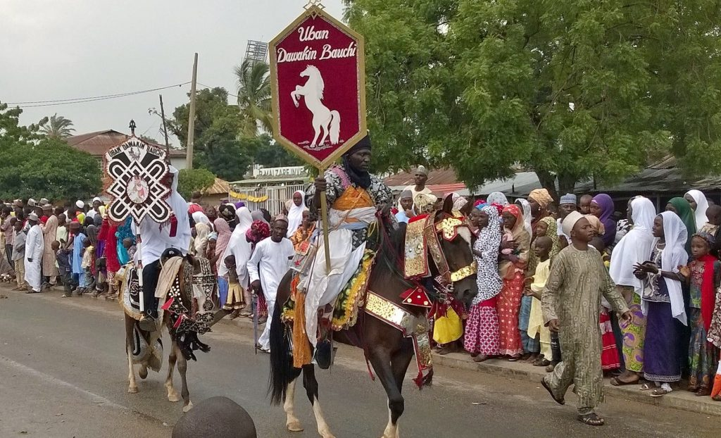 Durbar is a common Eid celebration in Muslim areas of Nigeria. Photo: https://commons.wikimedia.org/wiki/File:Durba_banner_carrier.jpg