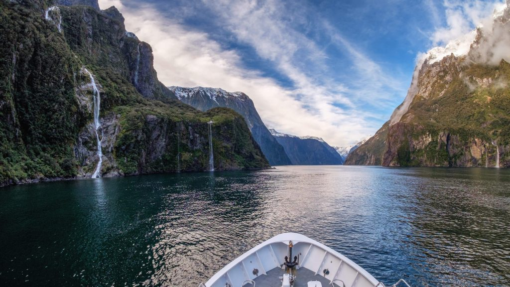looking out at Milford Sound's waterfalls from bow of boat